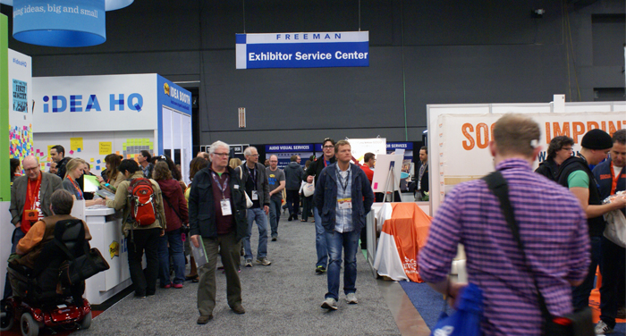 Attendees walk the SXSW Trade Show Floor