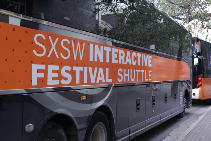 SXSW Shuttles line up outside the main convention center.